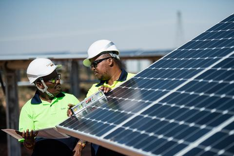 Operators checking solar panels installed at the TotalEnergies Sunpower solar power plant in Prieska.