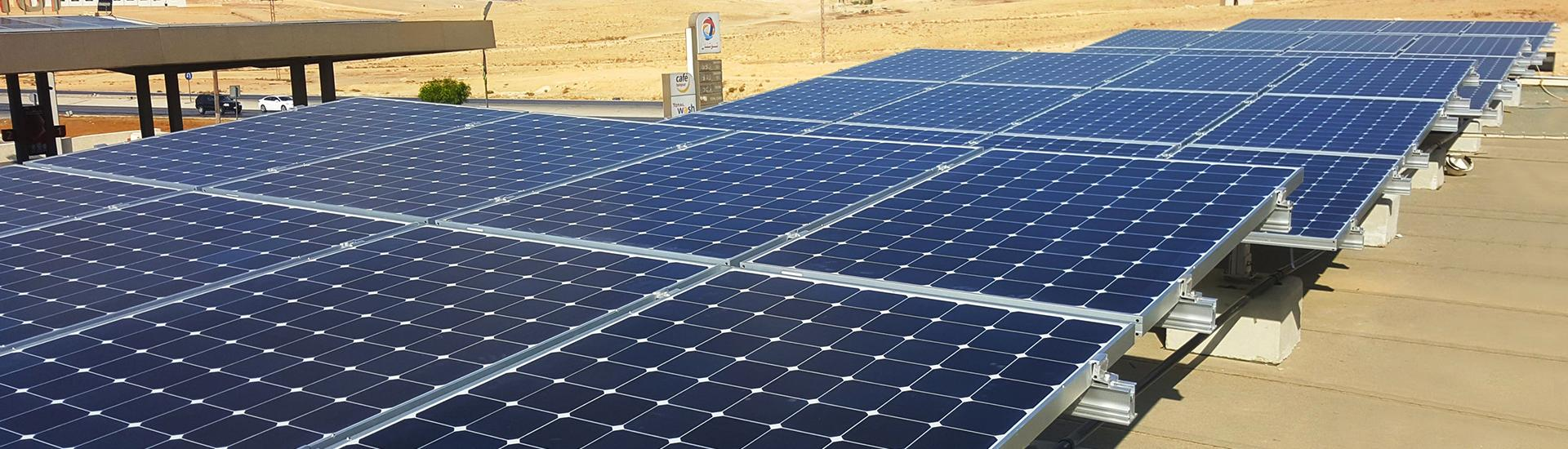 An installation of SunPower Solar Panels on the rooftop of a Total service station in Jordan.